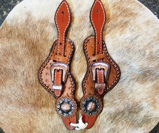 Hair on brown ostrich spur strap with copper hardware and spots