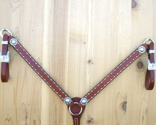 Straight leather breast collar with berry conchos and buckles