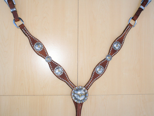 Leather breast collar with steerhead conchos and silver spots